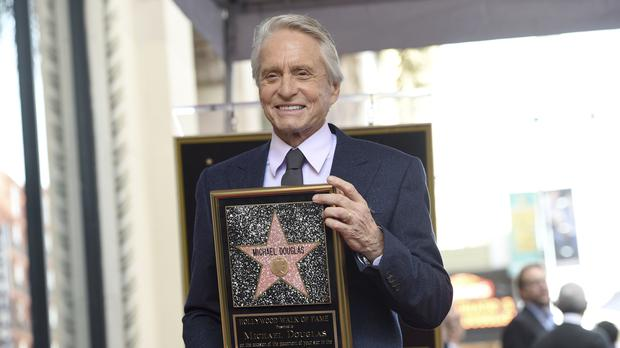 Emotional Michael Douglas was rewarded with a star on the Hollywood Walk Of Fame (Photo by Chris Pizzello / Invision / AP)