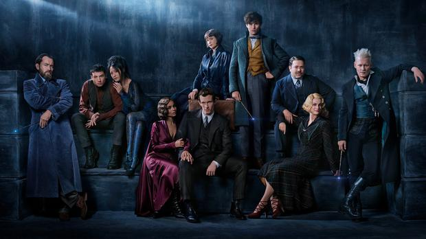 The cast for Fantastic Beasts: The Crimes Of Grindelwald. From the left is: Jude Law as Albus Dumbledore, Ezra Miller as Credence, Claudia Kim as a Maledictus, Zoe Kravitz as Leta Lestrange, Callum Turner as Theseus Scamander, Katherine Waterston as Tina Goldstein, Eddie Redmayne as Newt Scamander, Dan Fogler as Jacob Kowalski; Alison Sudol as Queenie Goldstein and Johnny Depp as Gellert Grindelwald.