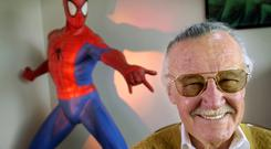 Fans flocked to Stan Lee's Walk of Fame star on Hollywood Boulevard to pay tribute (AP Photo/Reed Saxon, File)