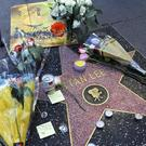 A wreath and other memorabilia adorn the star of Stan Lee on the Hollywood Walk of Fame, Monday, Nov. 12, 2018, in Los Angeles. Lee, the creative dynamo who revolutionized the comic book and helped make billions for Hollywood by introducing human frailties in superheroes such as Spider-Man, the Fantastic Four and the Incredible Hulk, died Monday. He was 95. (AP Photo/Reed Saxon)