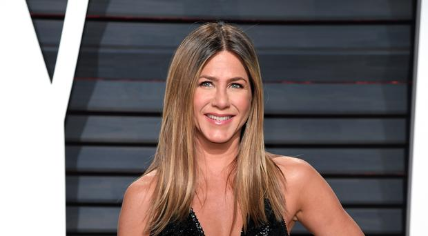 Jennifer Aniston stars as a beauty queen-turned-pageant judge in her latest film Dumplin' (PA)
