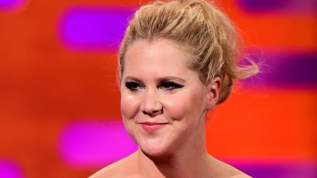 Pregnant Amy Schumer has postponed several tour dates due to illness (Ian West/PA)