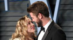 Miley Cyrus and Liam Hemsworth (PA)