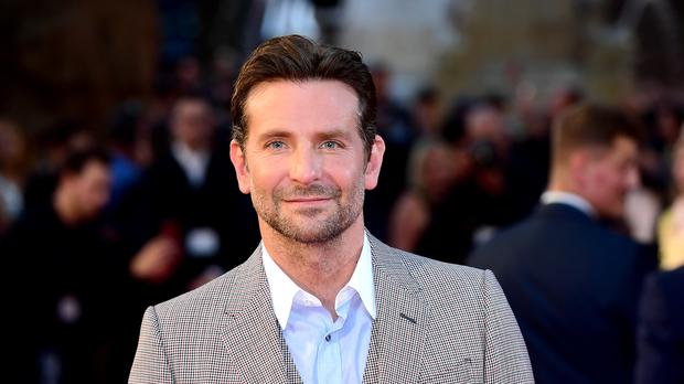Bradley Cooper has revealed his Bafta-nominated directorial debut film almost had a very different opening (Ian West/PA)