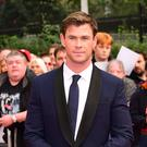 Chris Hemsworth has been bantering with Dwayne Johnson on Twitter (Ian West/PA)