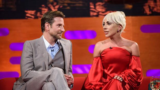 Bradley Cooper joins Lady Gaga on stage for surprise