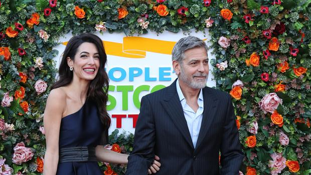 The Clooneys arrive at the People's Postcode Lottery event t the McEwan Hall in Edinburgh (Andrew Milligan/PA)