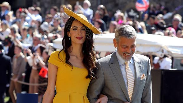 Amal and George Clooney (Chris Radburn/PA)