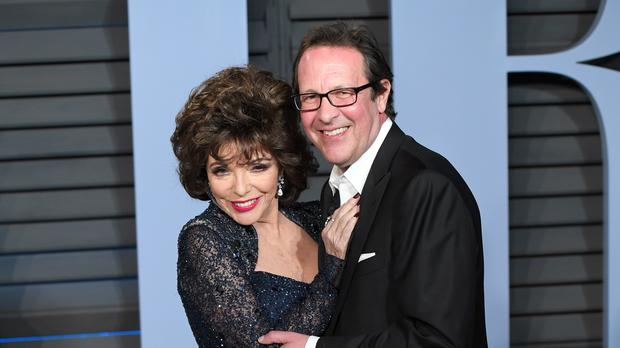 Dame Joan Collins and husband Percy Gibson were forced to flee their London home after a fire broke out (PA)