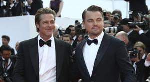Leonardo DiCaprio (right) and Brad Pitt posed on the red carpet as audiences got their first look at Once Upon A Time In Hollywood (Joel C Ryan/Invision/AP)