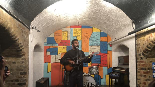 Himesh Patel, star of new Danny Boyle and Richard Curtis film Yesterday, performs on stage in a replica of The Cavern Club at The Beatles Story in Liverpool (Eleanor Barlow/PA)