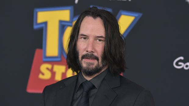 The boss of Marvel Studios has revealed he has been trying to recruit Keanu Reeves to star in a superhero film (Richard Shotwell/Invision/AP)