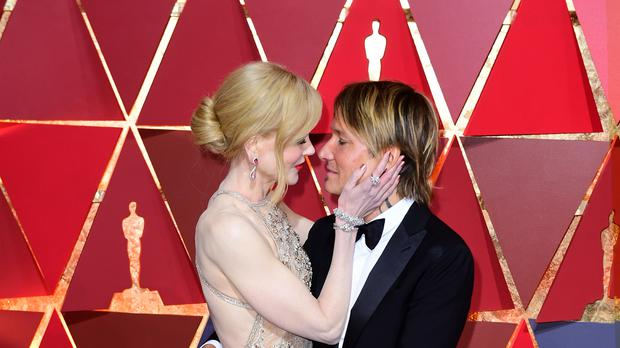 Nicole Kidman and Keith Urban shared loving messages on social media as they celebrated their 13th wedding anniversary (Ian West/PA)