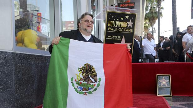 Mexican filmmaker Guillermo del Toro urged people to 'come together' as he was honoured with a star on the Walk Of Fame (Willy Sanjuan/Invision/AP)