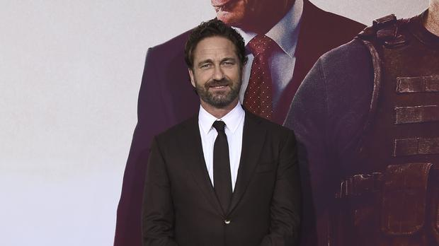 Gerard Butler said he 'loves' making action movies but admitted his tough guy roles have taken their toll on his body (Jordan Strauss/Invision/AP)