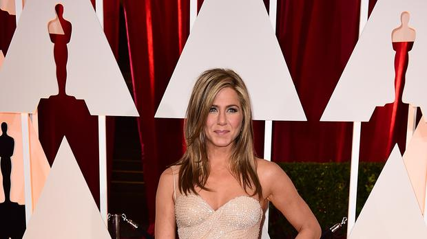 Jennifer Aniston has said Harvey Weinstein tried to force her to wear a dress from a clothing line owned by his then-wife (Ian West/PA)