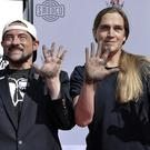 Kevin Smith (left) and Jason Mewes have placed their hands and feet in cement outside the TCL Chinese Theatre (Willy Sanjuan/Invision/AP)