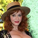 Mad Men actress Christina Hendricks has split from her husband of 10 years, the actor Geoffrey Arend (Willy Sanjuan/Invision/AP)