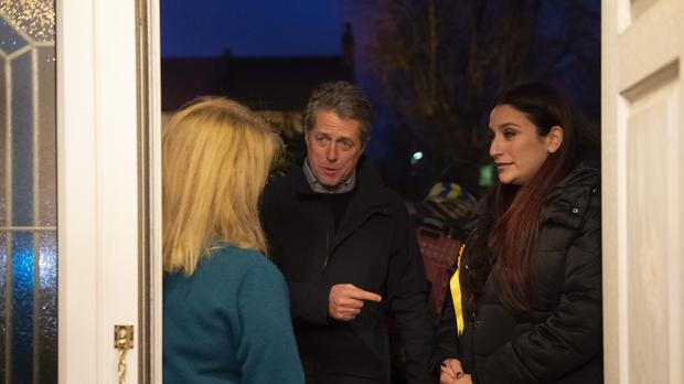 Liiberal Democrat candidate for Finchley and Golders Green, Luciana Berger and Hugh Grant canvassing in Finchley (David Mirzoeff/PA)