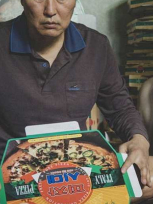 Song Kang-ho is the head of the Kim family, who make pizza boxes to get by