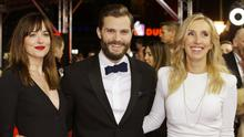 Actress Dakota Johnson (left), actor Jamie Dornan and director Sam Taylor-Johnson pose for photographers on the red carpet for the world premiere of Fifty Shades of Grey (AP)