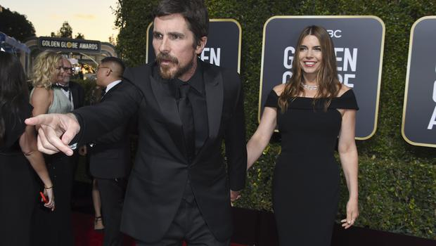 Christian Bale arriving at the Golden Globes with wife Sibi Blazic (Jordan Strauss/Invision/AP)