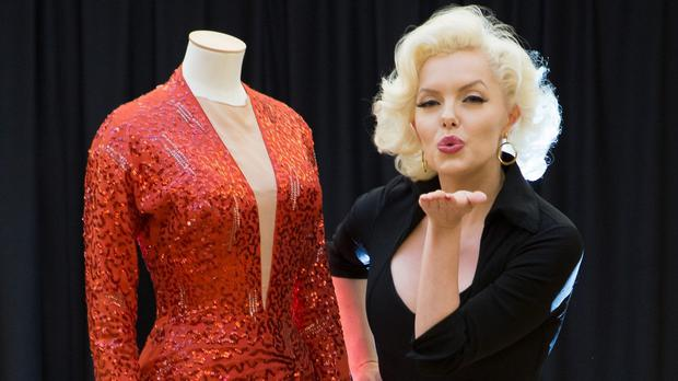 A Marilyn Monroe lookalike shows off the red sequinned gown from Gentlemen Prefer Blondes