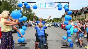 Emma Fogarty passing the finish line (Michael Scully/PA)
