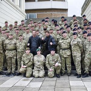 Hollywood actors Gerard Butler and Aaron Eckhart with soldiers from F Company the Scots Guards