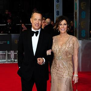 Tom Hanks and wife Rita Wilson arrive for the EE British Academy Film Awards 2014, at the Royal Opera House, London