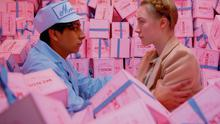 Quirky set: Tony Revolori and Saoirse Ronan in 'The Grand Budapest Hotel', with boxes designed by Annie Atkins.
