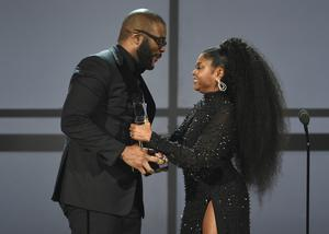 Tyler Perry accepted the ultimate icon award from presenter Taraji P Henson at the BET Awards (Chris Pizzello/Invision/AP)