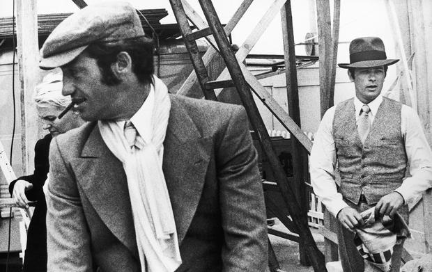 French actors Jean-Paul Belmondo, left, and Alain Delon during the shooting of a Jacques Deray film, Borsalino (AP)
