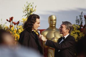 Statuesque figure: Daniel Day-Lewis is interviewed on the red carpet prior to the 1990 Academy Awards ceremony. Photo: Getty Images