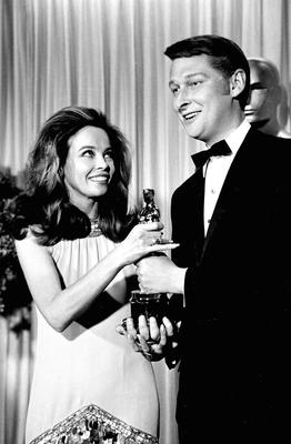 Here's to you: French actress-dancer Leslie Caron presents the Oscar for best director for the movie 'The Graduate' to Mike Nichols at the 1967 Academy Awards. Photo: AP