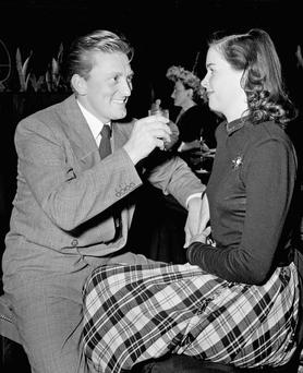In this Feb. 23, 1948 file photo, Kirk and Diana Douglas celebrate the completing of her latest picture,