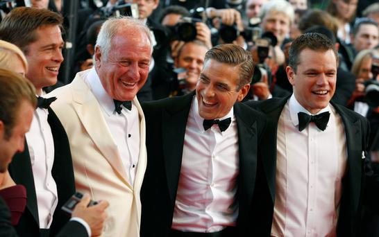 Producer Jerry Weintraub (C) stands with cast members (L-R) Brad Pitt, George Clooney and Matt Damon during arrivals for the world premiere of U.S. director Steven Soderbergh's film