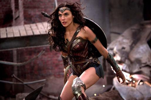 Shield, swords and lasso: Wonder Woman played by Gal Gadot goes back to her roots as a powerful superhero