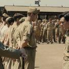 Jack O'Connell, right, as US air force bomber Louie Zamperini in 'Unbroken'