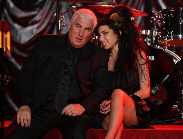 Amy Winehouse, pictured with her dad Mitch, fell into a spiral of drink and drugs that would kill the talented singer