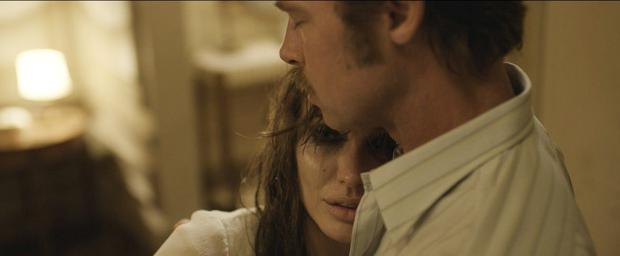 Lover hurts: Angelina Jolie stars in and directs this complicated love story with real-life hubby Brad Pitt.