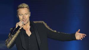 Irish singer and TV presenter Ronan Keating has accepted 'substantial damages' from the publisher of the News of the World over phone-hacking (Niall Carson/PA)