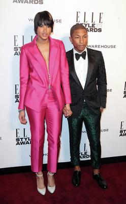 Happy: Pharrell and his very tall wife Helen