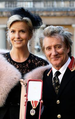Rod Stewart at Buckingham Palace with his wife Penny after he received a knighthood in 2016