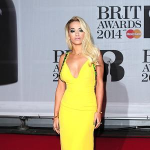 Rita Ora wore a long yellow gown on the red carpet