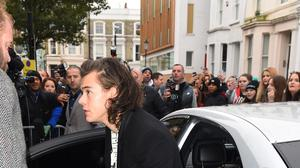 Singer Harry Styles arrives at a music studio to record his segment of the new Band Aid 30 charity single. (AP)