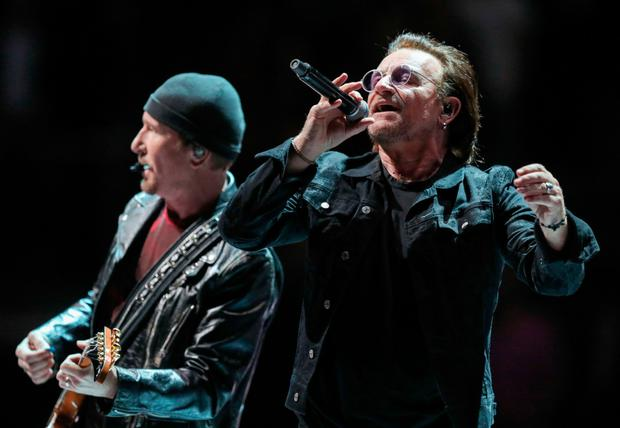 The Edge and Bono on stage at the O2 in London.