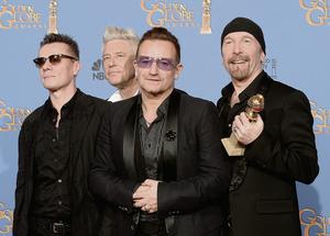 U2 with their Golden Globe for Best Original Song – 'Ordinary Love' from 'Mandela: Long Walk To Freedom' – in January.