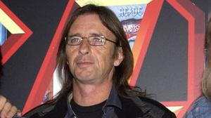 AC/DC's Phil Rudd has been charged with procuring murder