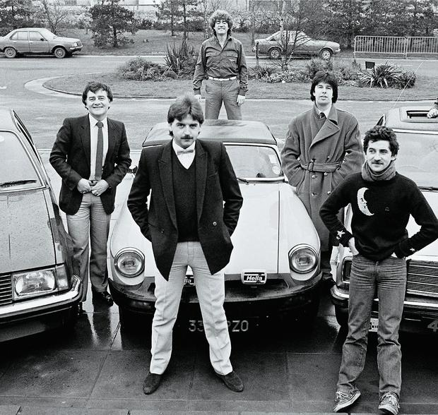 2fm DJs DJs pose with cars, in a shot taken for the RTE Guide in 1982